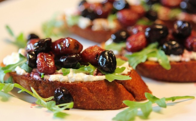Roasted Balsamic Grape Crostini with Ricotta and Arugula