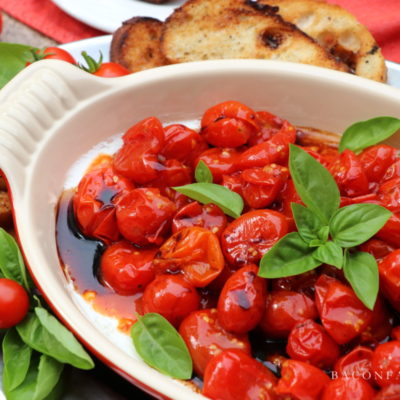 Roasted Cherry Tomatoes and Goat Cheese Spread with Fresh Basil and Balsamic Drizzle